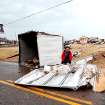 A worker removes debris from Broadway just north of Waterloo Road in Logan County, Okla., after a storm, Tuesday, Feb. 10, 2009. PHOTO BY BRYAN TERRY, THE OKLAHOMAN