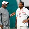 Former players Doug Williams, left, and Lee Roy Selmon chat during the Tampa Bay Buccaneers NFL football training camp Wednesday, July 30, 2008, in Lake Buena Vista, Fla. (AP Photo/St. Petersburg Times, Brian Cassella)