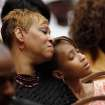 Maya Woodson, 12,  rests her head against the shoulder of her mother, Deidre Woodson. Deidre's husband, Harold Woodson was an honorary pallbearer. About 2,500 people celebrated the life and legacy of Oklahoma City civil rights pioneer Clara Mae Shepard Luper  during a lively service in the Cox Convention Center that lasted more than three hours, Friday,  June 17, 2011.  Luper died  last week at the age of 88. Photo by Jim Beckel, The Oklahoman