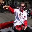 Parade grand marshal and former Cincinnati Reds baseball player Aaron Boone gestures to fans during the Reds Opening Day baseball parade in downtown Cincinnati, Thursday April 5, 2012. The Reds open the season against the Miami Marlins later in the day. (AP Photo/Tom Uhlman)