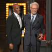 "Clint Eastwood, right, presents the award for best direction in a play to Kenny Leon for ""A Raisin in the Sun"" at the 68th annual Tony Awards at Radio City Music Hall on Sunday, June 8, 2014, in New York. (Photo by Evan Agostini/Invision/AP)"