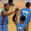 Oklahoma City Thunder forward Kevin Durant, left, high-fives teammate Reggie Jackson during the second half of an NBA basketball game against the Houston Rockets in Houston on Friday, April 4, 2014. Durant extended his streak of scoring at least 25 points to a 40th consecutive game, the longest streak since Michael Jordan reached 40 in 1986-87. The Rockets won 111-107. (AP Photo/Richard Carson)