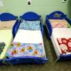 Tiny beds for toddlers are seen lined up in a row during a tour of the Pauline E. Mayer Children's Shelter in Oklahoma City, on Monday,  Jan. 23, 2012.   Photo by Jim Beckel, The Oklahoman