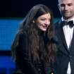 "Lorde, left, and Joel Little accept the award for song of the year for ""Royals,"" at the 56th annual Grammy Awards at Staples Center on Sunday, Jan. 26, 2014, in Los Angeles. (Photo by Matt Sayles/Invision/AP)"