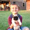 Landon Smith and Penny the Pug mug for the camera.  Community Photo By:  Harolda Gibson  Submitted By:  Harolda, Norman