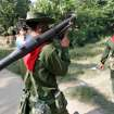 In this photo taken on Nov. 11, 2012, Myanmar soldiers and police walk as they provide security in Sittwe, Rakhine State, western Myanmar. Ethnic Kachin rebels in Myanmar say clashes in the country's north are continuing despite a government promise to cease fire. An official with the Kachin Independence Army says government forces stopped attacks Saturday, Jan. 19, 2013 around an army base at Lajayang, just south of the rebel-held town of Laiza. But the official says army assaults are under way elsewhere on least three other rebel positions in the region.  (AP Photo/Khin Maung Win)