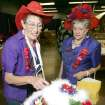 Betty Rothfusz, left and her sister Lucille Patrick look at Lucille's hat before the best decorated hat contest at State Fair Park in Oklahoma City , Okla. September 12 , 2008. Both women are members of Apple Blossom Sisters in Moore.  BY STEVE GOOCH, THE  OKLAHOMAN.
