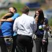 Wal-Mart employees hug outside a store after a shooting at the store and a nearby CiCi's Pizza in Las Vegas, Sunday, June 8, 2014. A man and a woman ambushed two police officers eating lunch at the Las Vegas restaurant, fatally shooting them at point-blank range before fleeing to a nearby Wal-Mart where they killed a third person and then themselves in an apparent suicide pact, authorities said Sunday. (AP Photo/Las Vegas Review-Journal, K.M. Cannon)