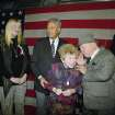 """FILE - In this Sunday, Jan. 17, 1993 file photo, actor Mickey Rooney, right, leans in to talk to Dr. Ruth Westheimer, center, as they wait with New York City Major David Dinkins, second from left, at Penn Station New York, headed for Washington aboard a special train to attend festivities surrounded the inauguration of President-elect Bill Clinton. The woman on the left is unidentified. In 1980, Westheimer broke into late-night radio with """"Sexually Speaking,"""" launching a career as confider-in-chief. The voice that Westheimer found on radio, and in the books and television shows that followed, pushed the boundaries of popular culture, declaring it not just safe, but healthy, for people to speak explicitly about their sex lives. A generation after the country embraced the Ruthian ethic of sexual honesty and moved on, what's left for Dr. Ruth, now an octogenarian grandmother, to talk about? Plenty, as it turns out. (AP Photo/Teddy Blackburn)"""