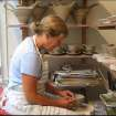 Pottery instructor Birthe Flexner at work in her studio.  Community Photo By:  Birthe Flexner  Submitted By:  Chuck, Norman