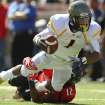 West Virginia's Tavon Austin is tackled by Texas Tech's D.J. Johnson during an NCAA college football game in Lubbock, Texas, Saturday, Oct. 13, 2012. (AP Photo/Lubbock Avalanche-Journal, Stephen Spillman) LOCAL TV OUT