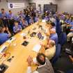In this photo provided by NASA, the Mars Science Laboratory (MSL) team welcomes White House Science and Technology Advisor John Holdren, third standing from left, as he stops by to meet the landing team and to say