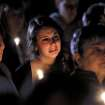 A young woman cries during the candlelight vigil on Saturday night, Oct. 13, 2012, at the Bay State Commons, for Westboro's Elizabeth