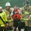 RAIN / FLOOD / FLOODING: Oklahoma City firefighters rescued stranded motorist Randy Robinson from  a bridge near Hefner Road and Sooner in Oklahoma City, Oklahoma June 14 , 2010. Photo by Steve Gooch, The Oklahoman ORG XMIT: KOD