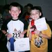 Kyle McKinley (left) won first place in the Oklahoma State Fair Spelling.  He is shown here with his blue ribbon and medallion.  Also shown is Caleb Shaw (right), who won second place.  Community Photo By:  Ryan McKinley  Submitted By:  ryan, edmond