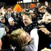 Auburn head coach Gus Malzahn celebrates with his wife Kristi after their 34-28 win over No. 1 Alabama in an NCAA college football game, Saturday, Nov. 30, 2013, at Jordan-Hare Stadium in Auburn, Ala. (AP Photo/AL.com, Julie Bennett) MAGS OUT