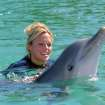 Women's United States Softball Team pitcher Jennie Finch swims with a dolphin in Freeport, Grand Bahama Sunday, Feb. 13, 2005. Finch hosted a children's softball clinic in Freeport on Saturday sharing her skills with the children of the island and the Bahamian National Team. Finch won her first gold medal at the 2004 Olympic Games in Athens and begins training next week for the upcoming season. (AP Photo/Tim Aylen)