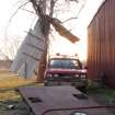 Debris from a nearby building hangs over a Wabaunsee County rural fire district truck following a tornado in Harveyville, Kan., Wednesday, Feb. 29, 2012, in Harveyville, Kan. The small eastern Kansas town of Harveyville took a direct hit from an apparent tornado late Tuesday, injuring at least 11 people and reducing much of the town to ruins.  (AP Photo/John Hanna) ORG XMIT: RPJH102