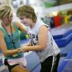 Seth Wedel of Jenks gets help around the balance beams from Gloria Hill, a camp counselor at Mat Trotters Gymnastics in Oklahoma City on Wednesday, July 27, 2011. Oklahomans Without Limits (OWL) is a summer camp for kids who are blind or visually impaired. The camp pairs each visually impaired child with a sighted buddy for the week long camp. Photo by John Clanton, The Oklahoman
