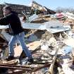 Tim Bondie sorts through what's left of his brother in law's home following deadly storms around Lone Grove, Okla., Feb. 11, 2009. By John Clanton, The Oklahoman