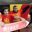 Belgium's Axel Witsel, left, and Nacer Chadli celebrate after they qualified for the World Cup at the end of the Group A qualifying soccer match against Wales at the King Baudouin stadium in Brussels, Tuesday, Oct. 15, 2013. (AP Photo/Yves Logghe)