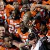 OKLAHOMA STATE UNIVERSITY / OSU / COLLEGE FOOTBALL / INSIGHT BOWL: Oklahoma State players and head coach Mike Gundy pose with the trophy after defeating Indiana 49-33 at the Insight Bowl college football game, Monday, Dec. 31, 2007 in Tempe, Ariz. (AP Photo/Mary Schwalm)  ORG XMIT: PNS115