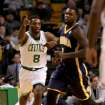 Boston Celtics small forward Jeff Green (8) reacts after hitting a 3-point basket as Indiana Pacers shooting guard Lance Stephenson (1) looks on during the first half of an NBA basketball game on Saturday, March 1, 2014, in Boston. (AP Photo/Mary Schwalm)