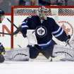 Tampa Bay Lightning's Ondrej Palat, not shown, scores on Winnipeg Jets goaltender Ondrej Pavelec (31) with Eric Tangradi (27) in the crease during the second period of an NHL hockey game Tuesday, Jan. 7, 2014, in Winnipeg, Manitoba. (AP Photo/The Canadian Press, Trevor Hagan)