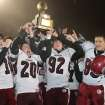 HIGH SCHOOL FOOTBALL / CELEBRATION: Shattuck players celebrate with the gold ball trophy after beating Tipton in the Class C state championship game on Friday, Dec. 2, 2011. PHOTO BY BRANDON NERIS, THE LAWTON-CONSTITUTION