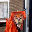 Shirts of Dutch soccer supporters hang outside an apartment prior to the start of the Euro 2012 soccer championship Group D match between the Netherlands and Germany in Amsterdam, Netherlands, Wednesday, June 13, 2012. (AP Photo/Margriet Faber)