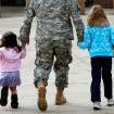 MILITARY DEPLOYMENT: A soldier holds the hands of two small girls as he walks with them into the Oklahoma City Arena to attend the 45th Infantry Brigade Combat Team deployment ceremony inside the Cox Convention Center,  Wednesday, Feb. 16, 2011.  Photo by Jim Beckel, The Oklahoman