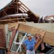 Johnny Hannah is shown on the back porch of his home near Guthrie after a tornado came through the area Tuesday afternoon. Photo by Jim Beckel, The Oklahoman