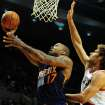 Phoenix Suns small forward P.J. Tucker (17) drive to the basket against Portland Trail Blazers center Robin Lopez during the first quarter of an NBA basketball game on Wednesday, Nov. 13, 2013, in Portland, Ore. (AP Photo/Steve Dykes)