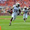Georgia Tech's Orwin Smith (17) heads to the end zone with a first-half touchdown while Robert Godhigh (25) begins to celebrate during an NCAA college football game against Clemson on Saturday, Oct. 6, 2012, at Memorial Stadium in Clemson, S.C. (AP Photo/ Richard Shiro)