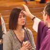 Rev. Shawn Monahan, of St. Mary's Catholic Church on Henry Street in Alton, Ill., applies the traditional ash cross on the forehead of a female parishioner Wednesday Feb. 22, 2012, during one of several Ash Wednesday masses held at the church. Some masses were mixed public and students from St. Mary's two schools. Ash Wednesday marks the beginning of the Season of Lent, which is a time of reflection, fasting and penance that ends on Easter Sunday. (AP Photo/The Telegraph, John Badman)