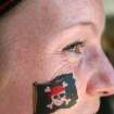 Arrrrg. Shannon Ratterman, J. D. McCarty Center physical therapist, shows off her team tattoo for the McCarty Centers Amazing Race team building exercise. The Amazing Race held Tuesday, August 1, was the kickoff event for the McCarty Center's employee appreciation month. Ratterman's team, the Physical Therapy Pirates, place second in the Amazing Race.  Community Photo By:  Greg Gaston  Submitted By:  Greg,