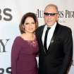 Gloria Estefan, left, and Emilio Estefan arrive at the 68th annual Tony Awards at Radio City Music Hall on Sunday, June 8, 2014, in New York. (Photo by Charles Sykes/Invision/AP)