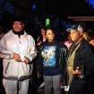 File - In this Nov. 6, 2013 file photo from left:  Pastor W. J. Rideout; Renisha McBride's aunt Bernita Spinks, and Ron Scott speak to the media during a vigil  in Dearborn Heights, Mich., for Renisha McBride in the front of the home where she shot on Nov. 2. Prosecutors plan to announce Friday, Nov. 15, 2013 whether they'll  charge a suburban Detroit homeowner in the shooting death of McBride. Autopsy results released after the shooting ruled McBride died of a gunshot wound to her face. (AP Photo/Detroit News, Ricardo Thomas, File)  DETROIT FREE PRESS OUT; HUFFINGTON POST OUT