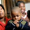 Edna Pittman poses with her children, Demarion (center), age 3, Destini, 5 and Deja, 10, at Gary Homsey's Law Offices in Oklahoma City,  Okla., on Tuesday, Jan. 8, 2007. Demarion suffered brain damage after a day care worker left him in a hot car. By John Clanton, The Oklahoman