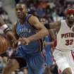 Oklahoma City Thunder's Russell Westbrook, left, dribbles past Detroit Pistons' Richard Hamilton (32) during the first half of their NBA basketball game on Friday, Dec. 26, 2008, in Auburn Hills, Mich. (AP Photo/Jerry S. Mendoza) ORG XMIT: MIJM102
