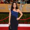 Julia Louis-Dreyfus arrives at the 20th annual Screen Actors Guild Awards at the Shrine Auditorium on Saturday, Jan. 18, 2014, in Los Angeles. (Photo by Jordan Strauss/Invision/AP)