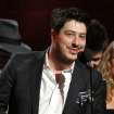 FILE - This Feb. 10, 2013 file photo shows Marcus Mumford accepting the award on stage for album of the year for