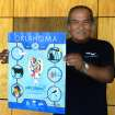 Doug Maytubbie, Native American artist, holds up the 2007 Global Oklahoma poster he designed and painted.  Community Photo By:  Steve Reeves  Submitted By:  Donna, Choctaw