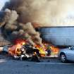 Flames engulf a passenger car and a tractor-trailer on the Long Island Expressway in Shirley, N.Y., Wednesday, Dec. 19, 2012. Police say one person has died and 32 people were injured in the massive traffic pileup that left dozens of vehicles littered across the main freeway on New York's Long Island. (AP Photo/Newsday, James Carbone) NYC OUT, NO SALES