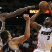Miami Heat's Dwyane Wade, right, shoots to the basket against San Antonio Spurs' DeJuan Blair, top left,and Nando De Colo, bottom, left, during the first quarter of an NBA basketball game in Miami, Thursday, Nov. 29, 2012. (AP Photo/El Nuevo Herald, Pedro Portal)  MAGAZINES OUT