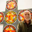 In this Sept. 24, 2013 photo, artist Robert Indiana, known world over for his LOVE image, is interviewed at New York's Whitney Museum of American Art in front of his piece