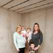 REESE DANIELS / BRINKLEE LEBLANC / DRAKE LEBLANC: Jessica Daniels and her 17-month-old daughter Reese pose with Julie LeBlanc and her children 1-year-old Brinklee and 3-year-old Drake in the safe room of her Oak Tree home in Edmond, Oklahoma February 12, 2009.  BY STEVE GOOCH, THE  OKLAHOMAN.  ORG XMIT: KOD
