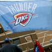Carlos Garcia, of Oklahoma City, carries a flag as he joins fans outside the OKC Arena before the first round NBA Playoff basketball game between the Thunder and the Nuggets at OKC Arena in downtown Oklahoma City on Wednesday, April 20, 2011. Photo by John Clanton, The Oklahoman