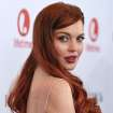 FILE - In this Nov. 20, 2012 photo, actress Lindsay Lohan attends a dinner celebrating the premiere of