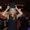 In this Saturday, Jan. 19, 2013 photo, actress AnnaLynne McCord tries on a cat-shaped knit hat at the